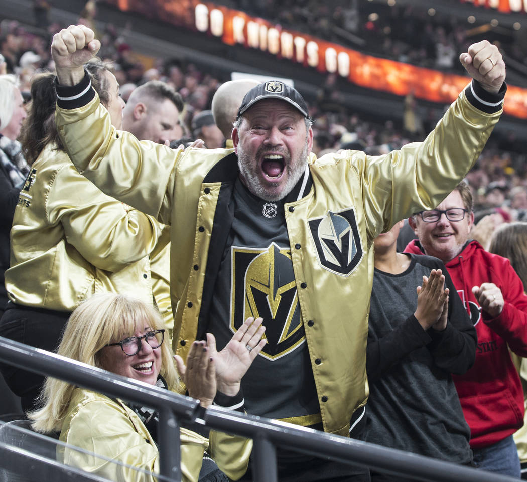 Golden Knights fans celebrate after Vegas scored a goal in the first period during their home matchup with the Minnesota Wild on Monday, Jan. 21, 2019, at T-Mobile Arena, in Las Vegas. (Benjamin H ...