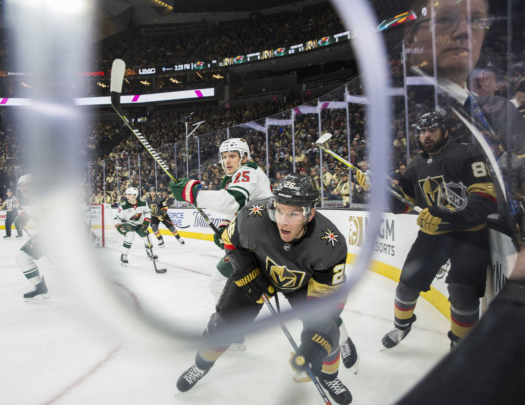 Golden Knights center Paul Stastny (26) fights for a loose puck with Minnesota Wild defenseman Jonas Brodin (25) in the first period on Monday, Jan. 21, 2019, at T-Mobile Arena, in Las Vegas. (Be ...