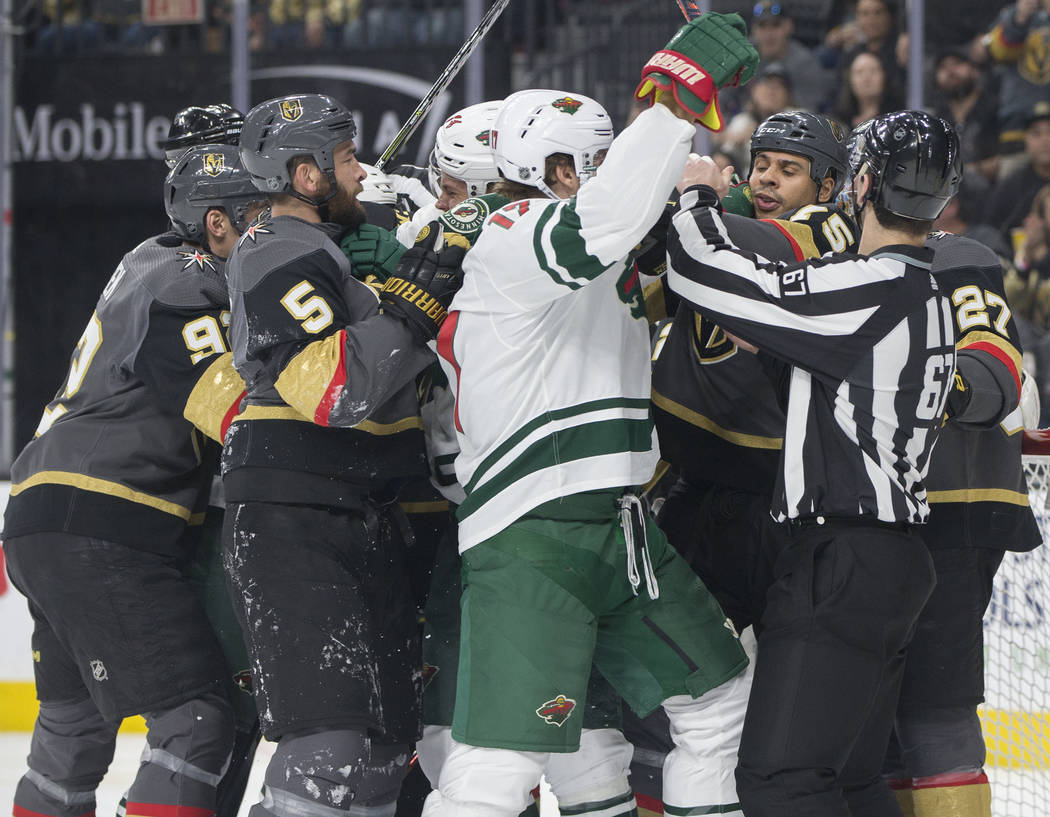 The Golden Knights and Minnesota Wild players fight in the second period on Monday, Jan. 21, 2019, at T-Mobile Arena, in Las Vegas. (Benjamin Hager/Las Vegas Review-Journal) @BenjaminHphoto