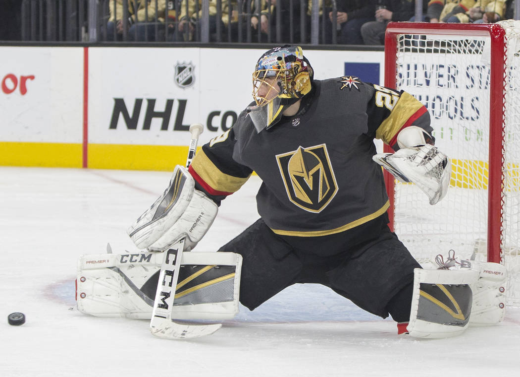Golden Knights goaltender Marc-Andre Fleury (29) makes a save in the second period during their home matchup with the Minnesota Wild on Monday, Jan. 21, 2019, at T-Mobile Arena, in Las Vegas. (Ben ...