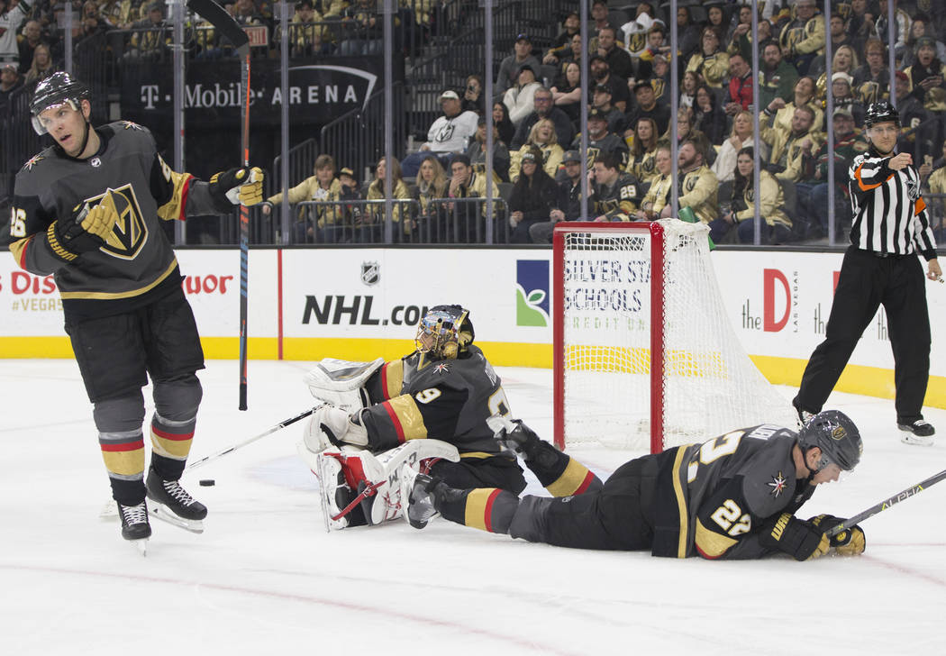 Golden Knights goaltender Marc-Andre Fleury (29), defenseman Nick Holden (22) and center Paul Stastny (26) react after giving up a goal in the second period during their home matchup with Minnesot ...