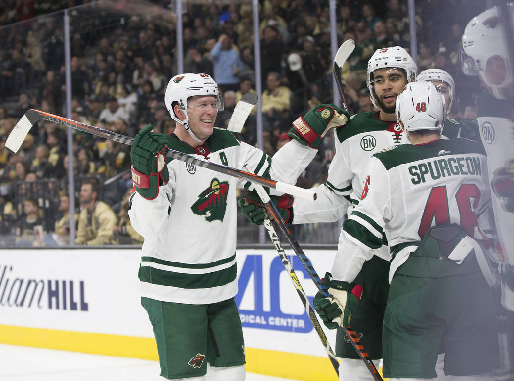 Minnesota Wild defenseman Ryan Suter (20) celebrates with teammates after left wing Marcus Foligno (17) scored a goal in the second period during their road matchup with the Golden Knights on Mond ...