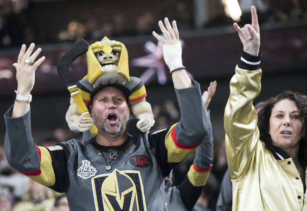 Golden Knights fans celebrate after Vegas scored a goal in the second period during their home matchup with the Minnesota Wild on Monday, Jan. 21, 2019, at T-Mobile Arena, in Las Vegas. (Benjamin ...