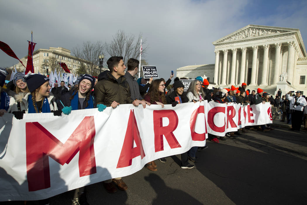 Anti-abortion activists march outside of the U.S. Supreme Court, during the March for Life in Washington Friday, Jan. 18, 2019. (AP Photo/Jose Luis Magana)