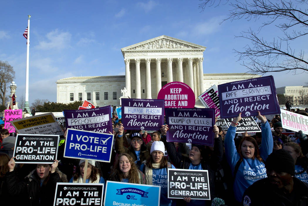 Anti-abortion activists protest outside of the U.S. Supreme Court, during the March for Life in Washington Friday, Jan. 18, 2019. (AP Photo/Jose Luis Magana)