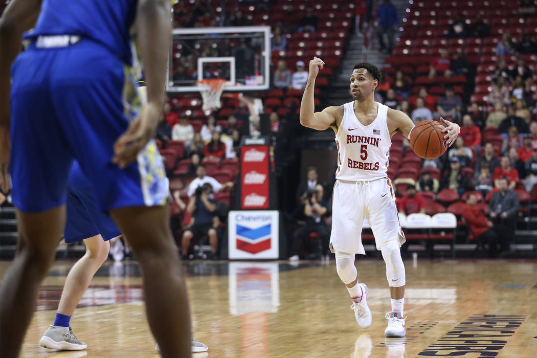 UNLV Rebels guard Noah Robotham (5) gestures to a teammate in the first half of the basketball game against the San Jose State Spartans at the Thomas & Mack Center in Las Vegas, Saturday, Jan. ...