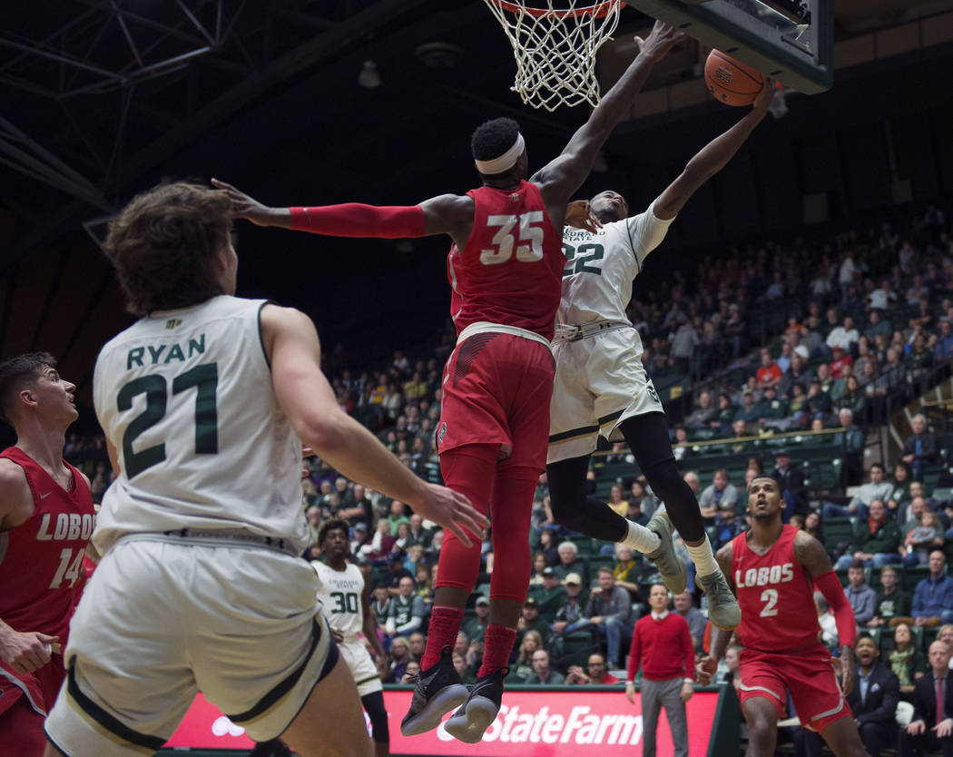 Colorado State guard J.D. Paige (22) lays up the ball past New Mexico forward Carlton Bragg (35) during an NCAA college basketball game, Saturday, Jan. 12, 2019, at Moby Arena in Fort Collins, Col ...