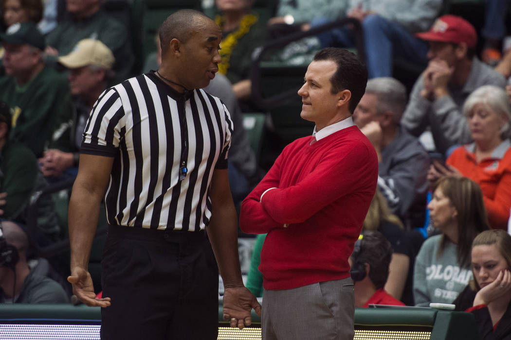 New Mexico head coach Paul Weir talks with an official during an NCAA college basketball game against Colorado State, Saturday, Jan. 12, 2019, at Moby Arena in Fort Collins, Colo. (Timothy Hurst/T ...