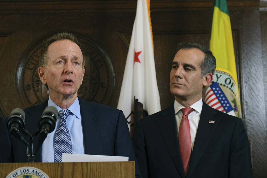 Austin Beutner, left, superintendent of the Los Angeles Unified School District, speaks during a news conference as Los Angeles Mayor Eric Garcetti listens after a tentative deal was reached Tuesd ...