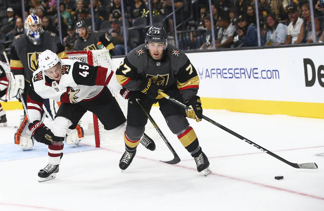 Golden Knights defenseman Brad Hunt (77) goes for the puck during the second period of a preseason NHL hockey game against the Arizona Coyotes at T-Mobile Arena in Las Vegas on Sunday, Sept. 16, 2 ...