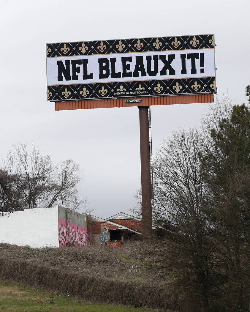A billboard protesting a controversial call in the Sunday's NFL football game between the New Orleans Saints and Los Angeles Rams is shown along Interstate 75 near Hartsfield Jackson Atlanta Inter ...
