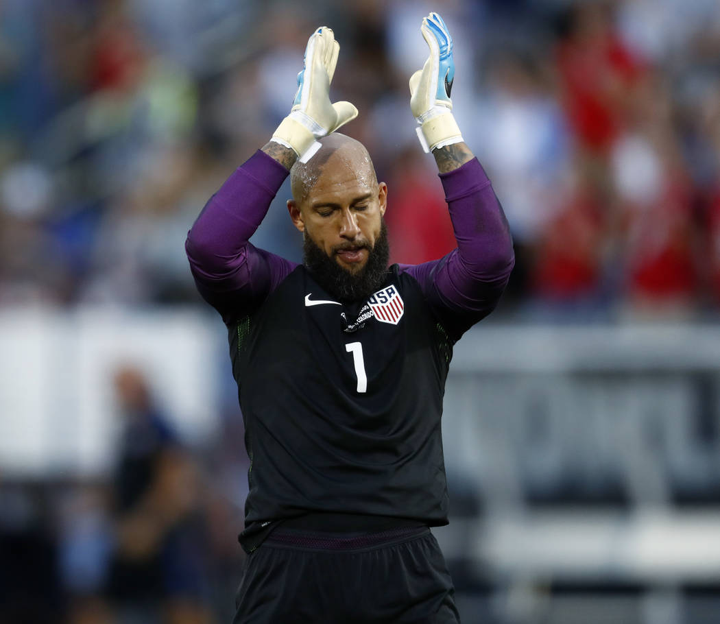 U.S. goalkeeper Tim Howard applauds as time runs out in the team's World Cup soccer qualifying match against Trinidad & Tobago on Thursday, June 8, 2017, in Commerce City, Colo. The United Sta ...