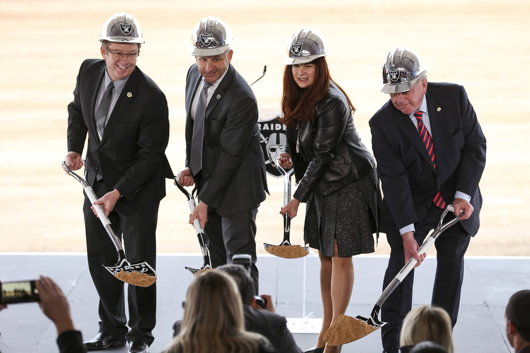 From left, Henderson City Manager Richard Derrick, Raiders President Marc Badain, Henderson Mayor Debra March and Henderson Councilman Dan Shaw pose for photos during a groundbreaking ceremony for ...