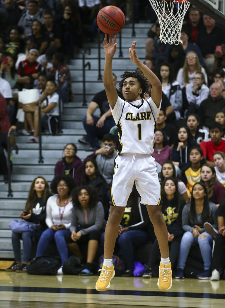 Clark's Frankie Collins (1) goes up to score a three-pointer against Bishop Gorman during a basketball game at Clark High School in Las Vegas on Tuesday, Jan. 30, 2018. Chase Stevens Las Vegas Rev ...