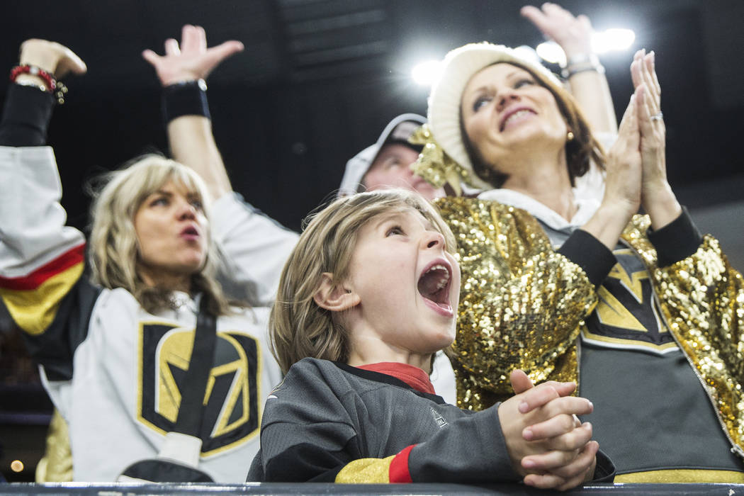 11268abb8 Golden Knights fan Mick Mugnier, 12, cheers for Vegas in the third period  during