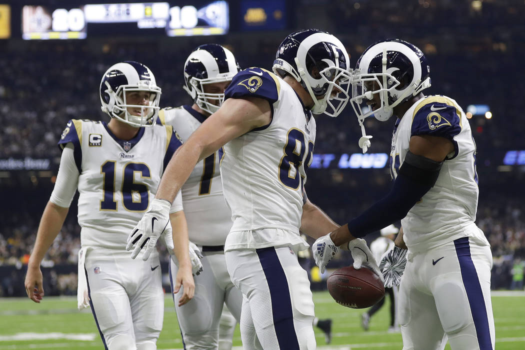Los Angeles Rams' Tyler Higbee celebrates his touchdown catch during the second half of the NFL football NFC championship game against the New Orleans Saints, Sunday, Jan. 20, 2019, in New Orleans ...