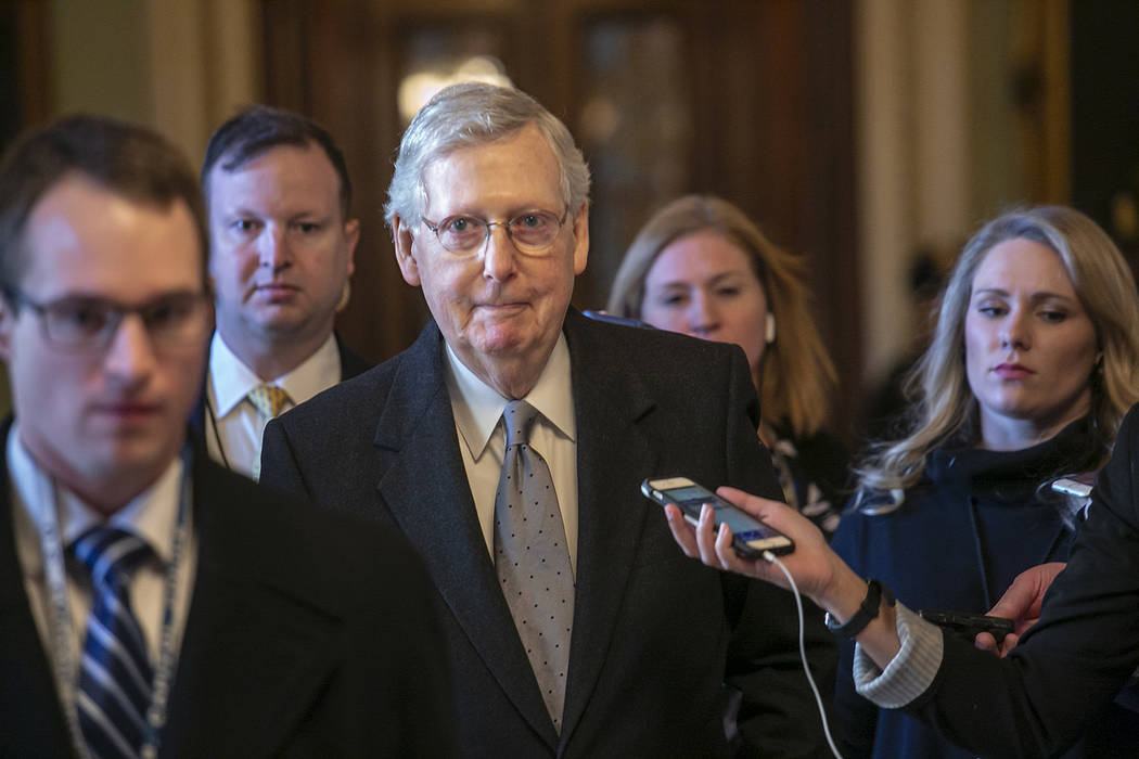 Senate Majority Leader Mitch McConnell, R-Ky., leaves the chamber after speaking about his plan to move a 1,300-page spending measure, which includes $5.7 billion to fund President Donald Trump's ...