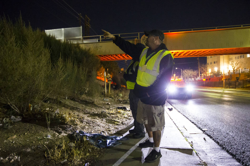 William Kight, center, looks for homeless people during the annual Southern Nevada Homeless Census in Las Vegas on Tuesday, Jan. 22, 2019. Kight, who is formerly homeless, was participating in his ...