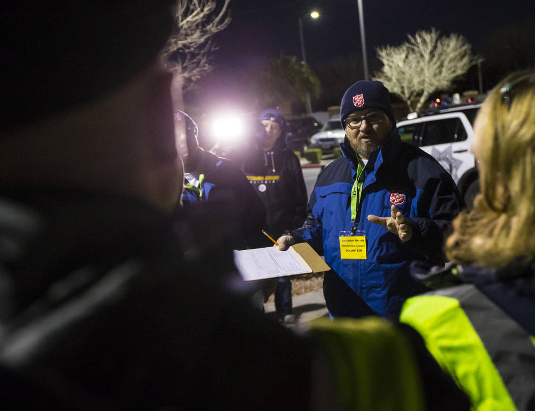 Ryan McDonald, homeless service coordinator at Salvation Army, talks with volunteers and participants at the start of the annual Southern Nevada Homeless Census in Las Vegas on Tuesday, Jan. 22, 2 ...