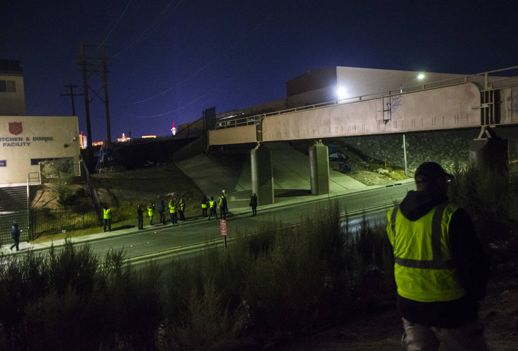 William Kight, right, looks around bushes for homeless people during the annual Southern Nevada Homeless Census in Las Vegas on Tuesday, Jan. 22, 2019. Kight, who is formerly homeless, was partici ...