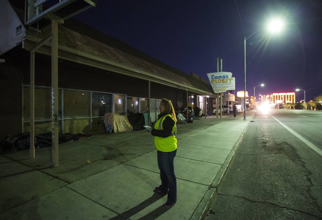 Jeree Saucedo, assistant director of social services at Salvation Army, looks for homeless people along Main Street during the annual Southern Nevada Homeless Census in Las Vegas on Tuesday, Jan. ...