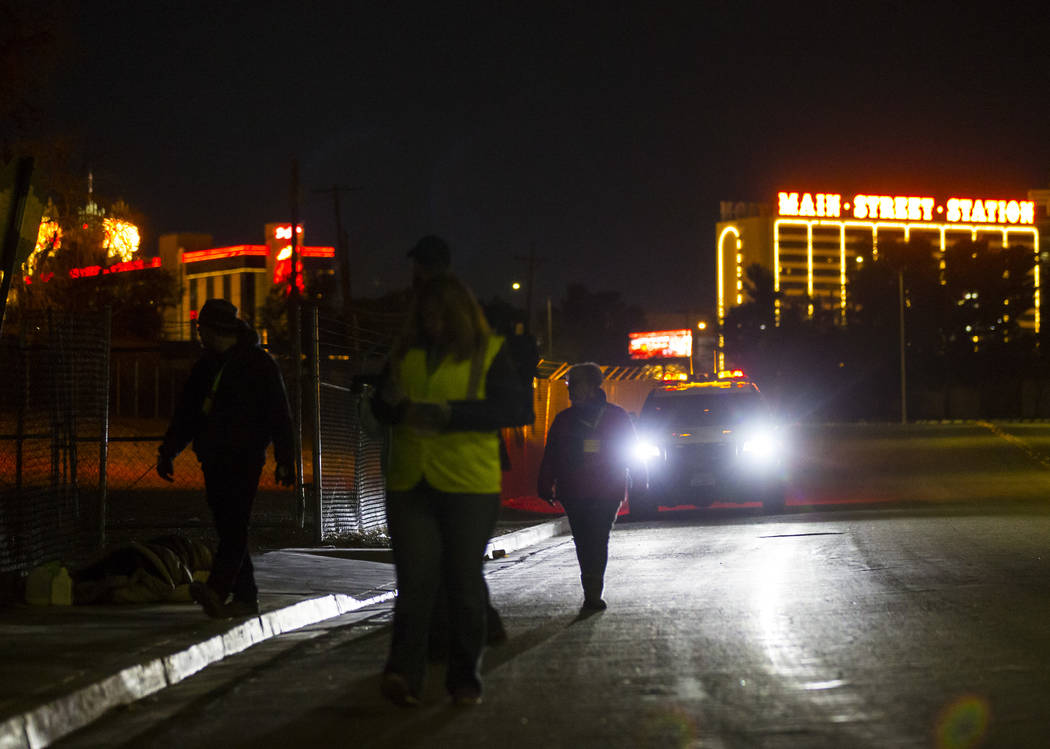 Volunteers look for homeless people along Veterans Memorial Drive during the annual Southern Nevada Homeless Census goes on in Las Vegas on Tuesday, Jan. 22, 2019. (Chase Stevens/Las Vegas Review- ...