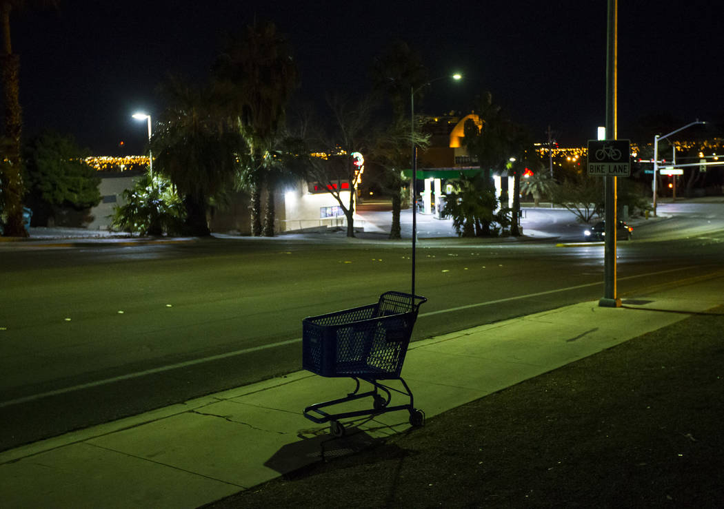 A lone shopping cart sits along Washington Avenue near Las Vegas Boulevard during the annual Southern Nevada Homeless Census in Las Vegas on Tuesday, Jan. 22, 2019. (Chase Stevens/Las Vegas Review ...