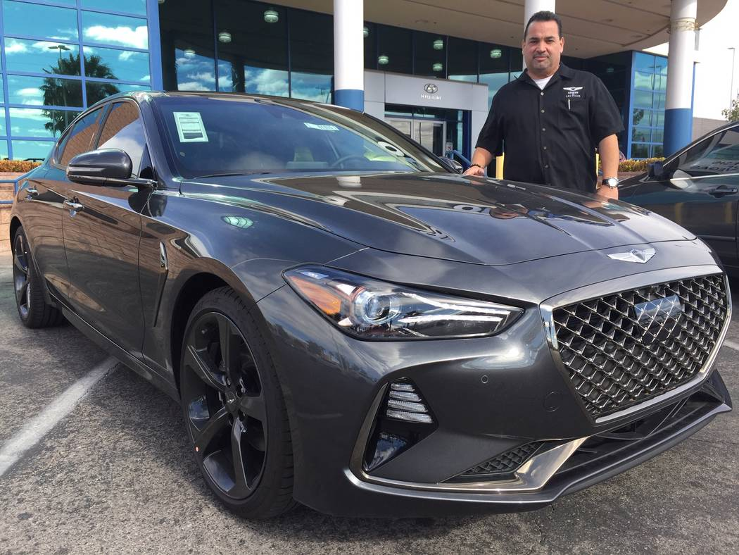 Genesis of Las Vegas manager Ernie Leon is seen with a 2019 Genesis G70 at 7150 W. Sahara Ave. (Genesis)