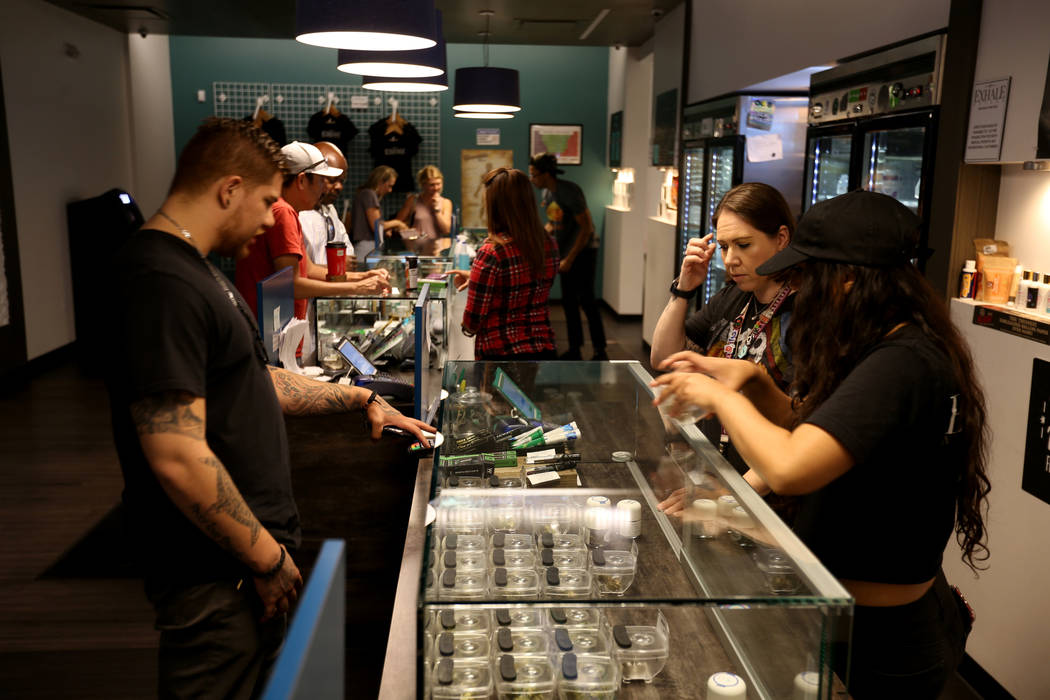 Eddie Medina of Seattle checks out product with Lindsay Steel, right, and Alyssa Jusino at Exhale Nevada marijuana dispensary in Las Vegas Thursday, June 28, 2018. (K.M. Cannon/Las Vegas Review-Jo ...