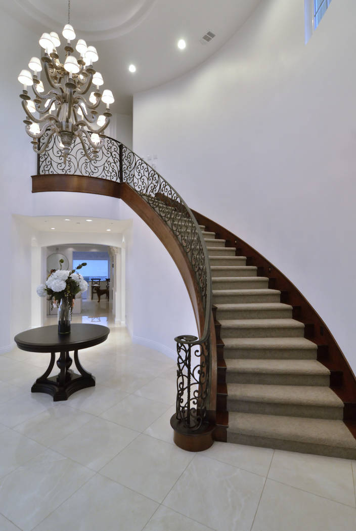The staircase leads to the second story of the Marchessault home. (Bill Hughes Real Estate)