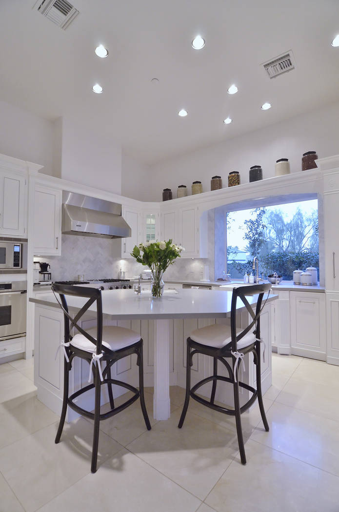 The kitchen has a unique shaped island. (Bill Hughes Real Estate Millions)