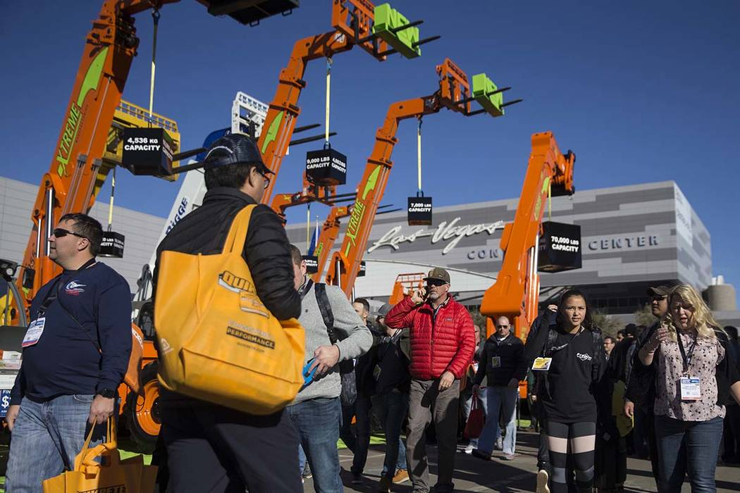 Convention goers explore outside exhibits during the first day of the World of Concrete on Tuesday, Jan. 22, 2019, at the Las Vegas Convention Center, in Las Vegas. (Benjamin Hager/Las Vegas Revie ...