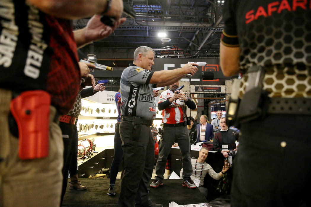 Keith Garcia of Team Safariland participates in a fast magazine reloading demonstration during the SHOT Show at the Sands Expo Convention Center in Las Vegas, Tuesday, Jan. 22, 2019. Erik Verduzco ...