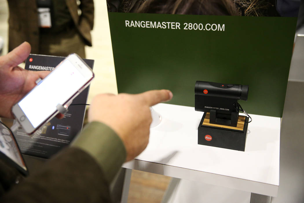 Hamilton Boykin, eastern sales manager for Leica, gives a demonstration of the newly released Rangemaster CRF 2800 during the SHOT Show at the Sands Expo Convention Center in Las Vegas, Tuesday, J ...