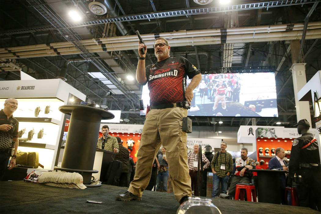 Rob Leatham of Team Safariland participates in a fast magazine reloading demonstration during the SHOT Show at the Sands Expo Convention Center in Las Vegas, Tuesday, Jan. 22, 2019. Erik Verduzco/ ...