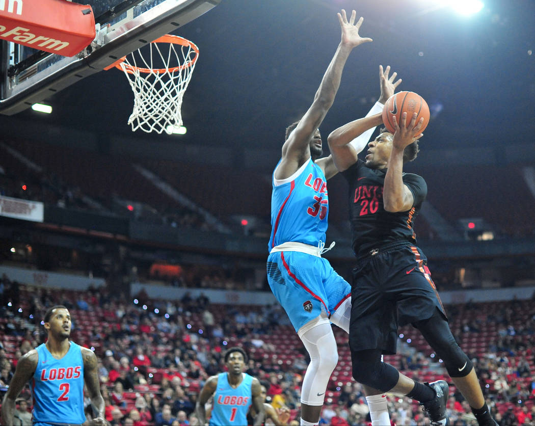 UNLV Rebels forward Nick Blair (20) goes for a layup against New Mexico Lobos forward Carlton Bragg (35) during the second half of the UNLV Rebels and the New Mexico Lobos NCAA basketball game at ...