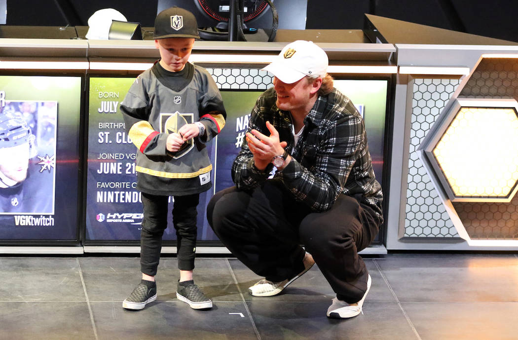 Vegas Golden Knights defenseman Nate Schmidt picks a fan from the crowd to play Mario Kart 8 Deluxe with him at the HyperX Esports Arena at the Luxor hotel-casino in Las Vegas, Tuesday, Jan. 22, 2 ...