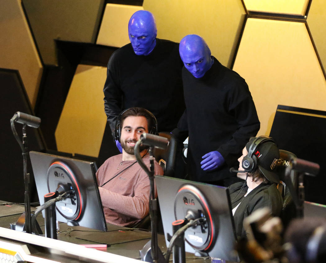 Members of the Blue Man Group arrive to play Mario Kart 8 Deluxe at the Vegas Golden Knights Twitch event with players Alex Tuch, left, and Erik Haula at the HyperX Esports Arena at the Luxor hote ...