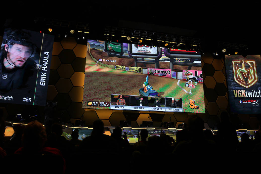 Fans watch as Vegas Golden Knights players Alex Tuch, Erik Haula, Colin Miller and Nate Schmidt play Mario Kart 8 Deluxe at the HyperX Esports Arena at the Luxor hotel-casino in Las Vegas, Tuesday ...