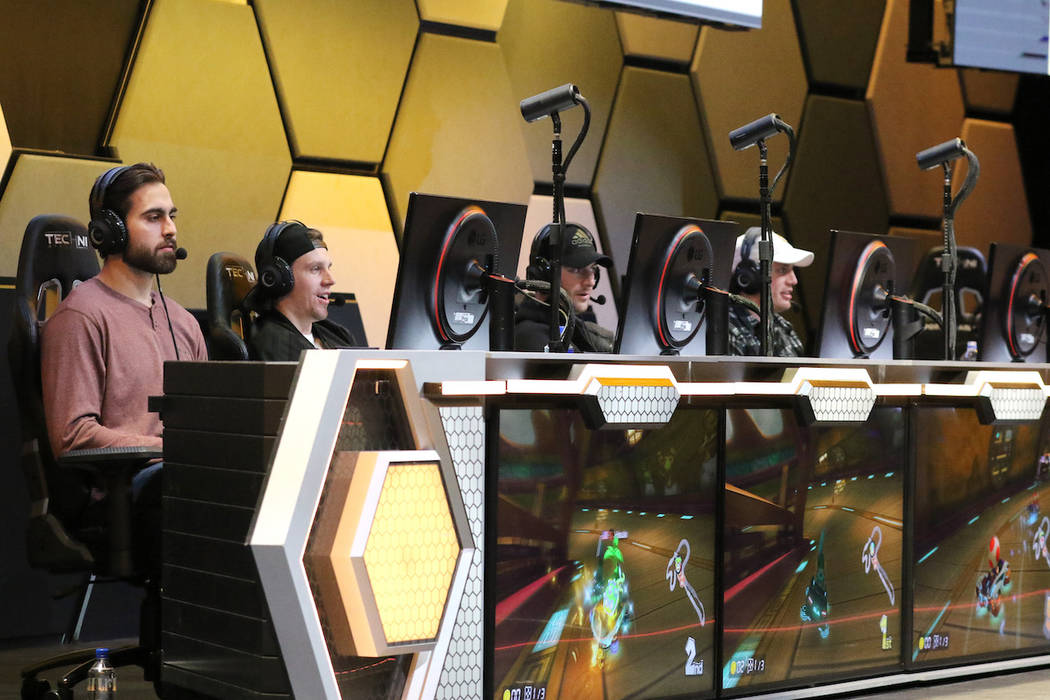Vegas Golden Knights players, from left, Alex Tuch, Erik Haula, Colin Miller and Nate Schmidt play Mario Kart 8 Deluxe at the HyperX Esports Arena at the Luxor hotel-casino in Las Vegas, Tuesday, ...