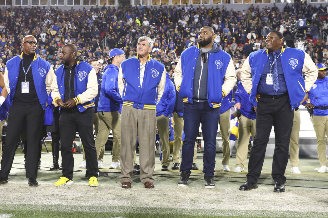 (Left to right) Los Angeles Rams Hall of Famers Eric Dickerson, Marshall Faulk, Tom Mack, Orlando Pace, and Jackie Slater look on prior to an NFL divisional playoff game against the Dallas Cowboys ...