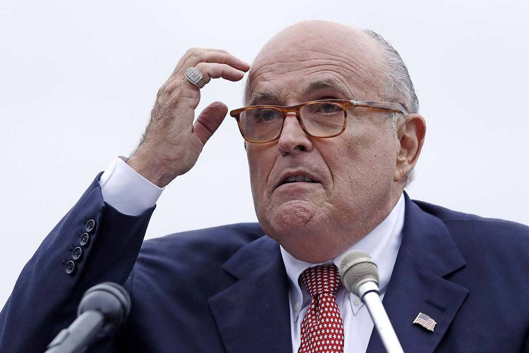 In this Aug. 1, 2018 file photo, Rudy Giuliani, an attorney for President Donald Trump, speaks in Portsmouth, N.H. Giuliani's latest scattershot media blitz, which was filled with a dizzying arr ...