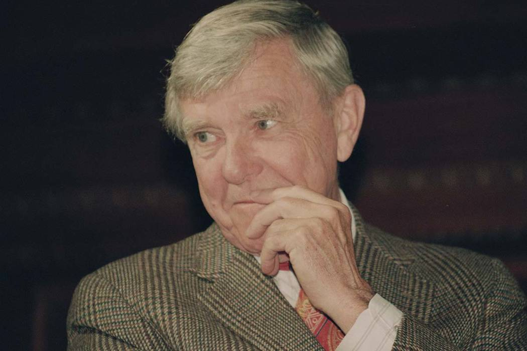 In this Tuesday, Feb. 23, 1993 file photo, writer Russell Baker, ponders a reporter's question during a New York news conference where he was presented as the successor to host Alistair Cooke for ...