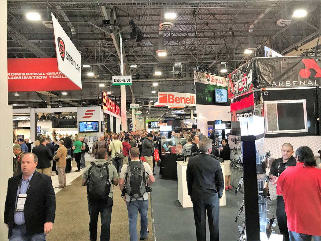 People from all 50 states and more than 100 countries find more than 12.5 miles of aisles lined with industry-related exhibits during the Shooting, Hunting and Outdoor Trade (SHOT) Show in Las Veg ...