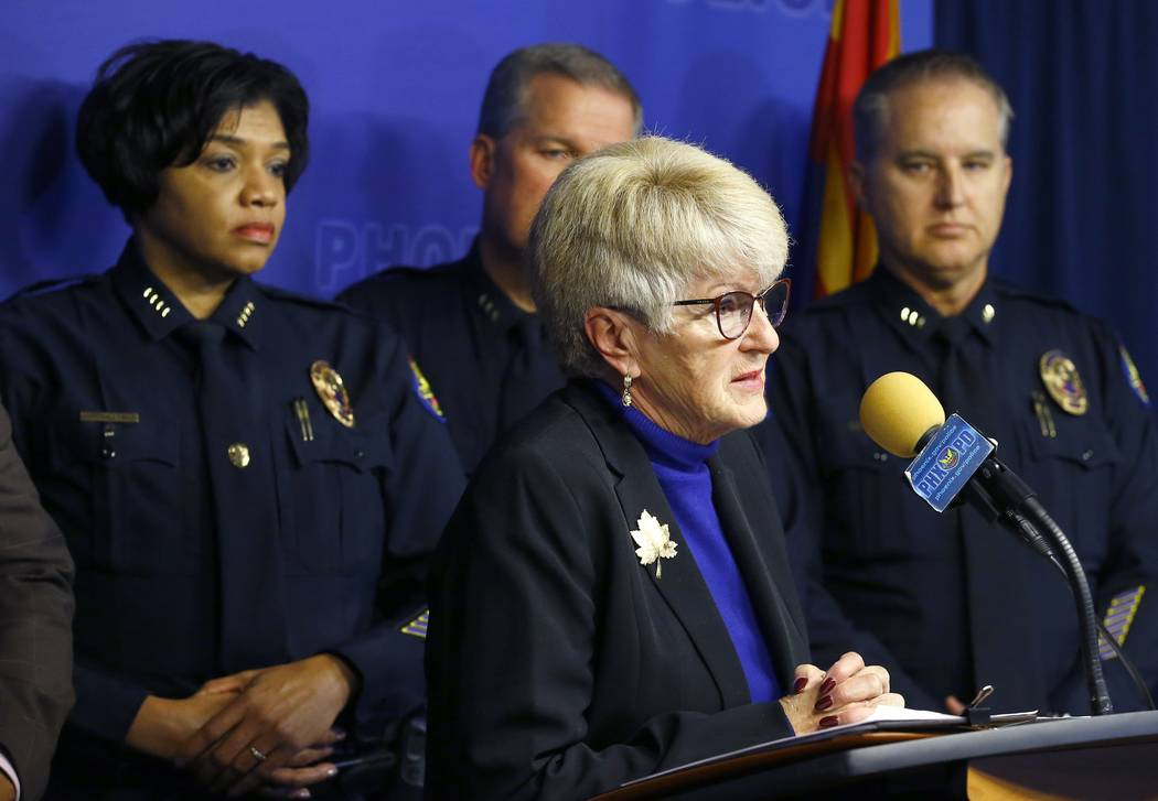 Phoenix Mayor Thelda Williams, front right, speaks during a news conference as she is joined by Phoenix Police Chief Jeri Williams, left, and other members of law enforcement as they announce that ...