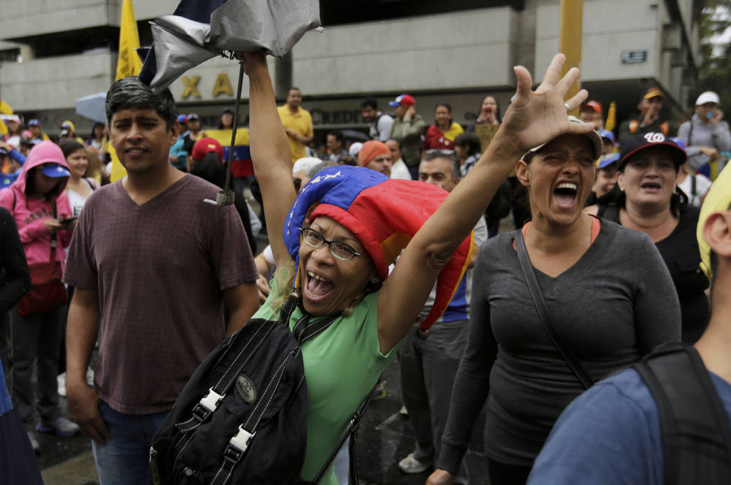Opposition members shout slogans against Venezuela's President Nicolas Maduro during a protest in Caracas, Venezuela, Wednesday, Jan. 23, 2019. (Fernando Llano/AP)