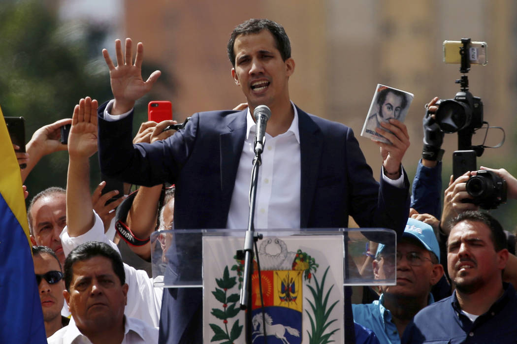 Juan Guaido, head of Venezuela's opposition-run congress, declares himself interim president of Venezuela, during a rally demanding President Nicolas Maduro's resignation in Caracas, Venezuela, We ...