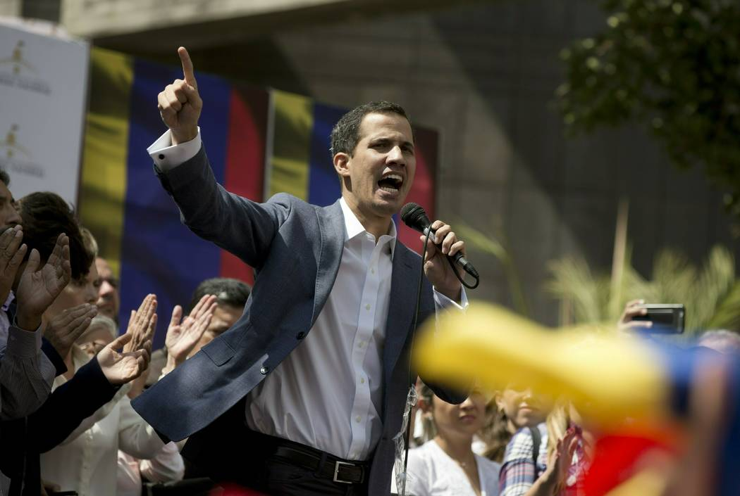 Juan Guaido, president of the Venezuelan National Assembly, delivers a speech during a public legislative session in Caracas, Venezuela, Jan. 11, 2019. Guaido, head of Venezuela's opposition-run c ...