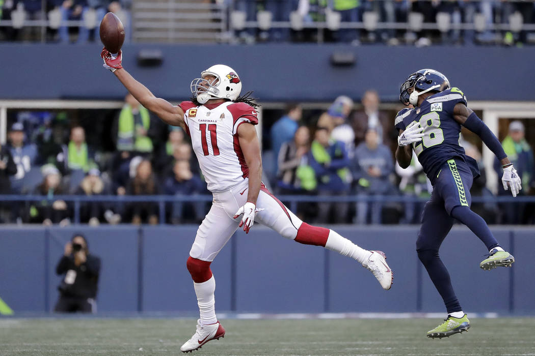 Arizona Cardinals' Larry Fitzgerald (11) just misses a catch in front of Seattle Seahawks' Justin Coleman during the first half of an NFL football game, Sunday, Dec. 30, 2018, in Seattle. (AP Phot ...