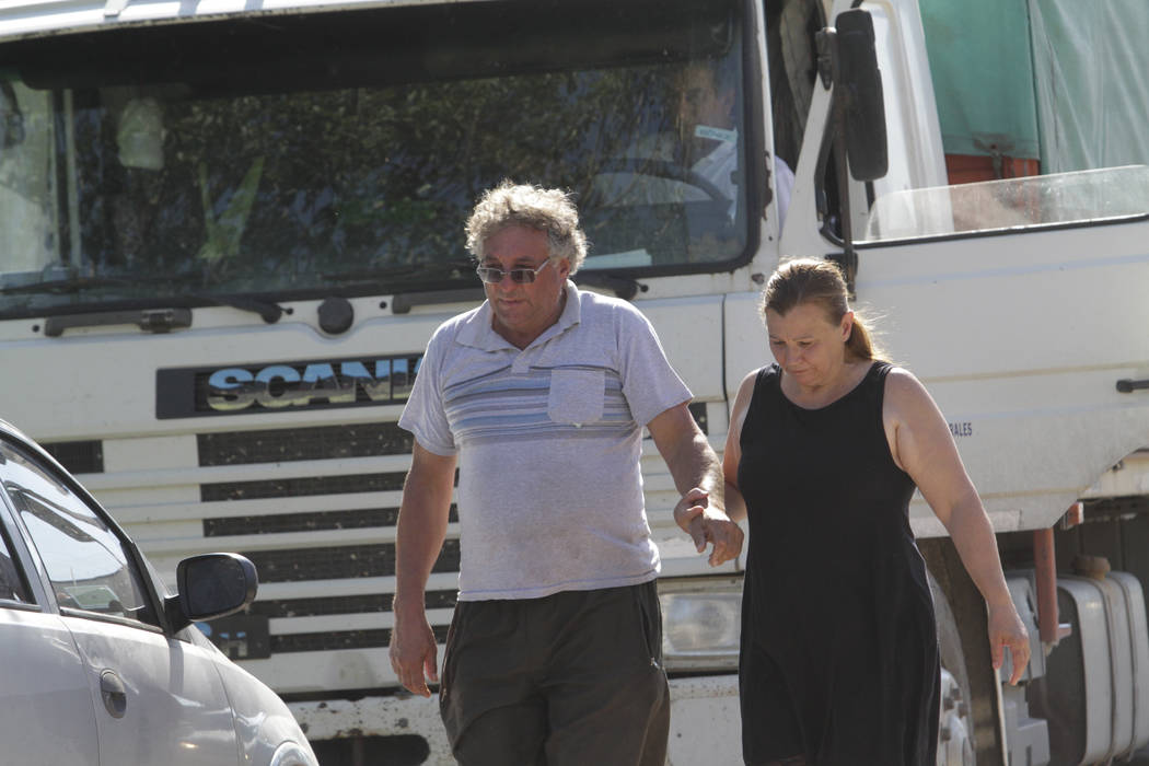 CORRECTS NAME OF PARTNER - Horacio Sala, father of Argentine soccer player Emiliano Sala, holds hands with his partner Liliana Ponce outside their home in Progreso, Argentina, Tuesday, Jan. 22, 20 ...